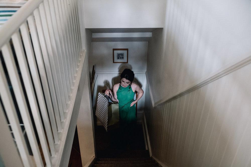 Bridesmaid climbing stairs