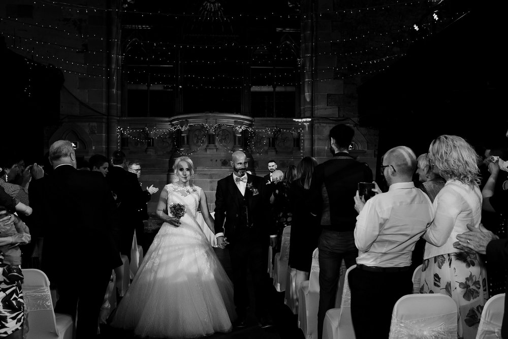 Bride and groom recessional in Cottiers