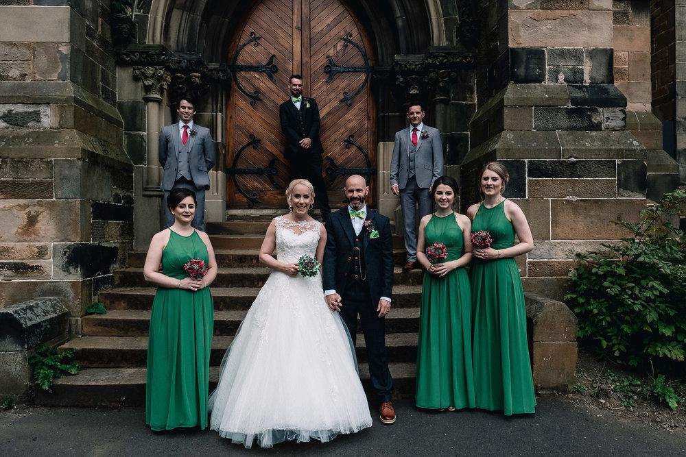 Bridal party portrait outside Cottiers