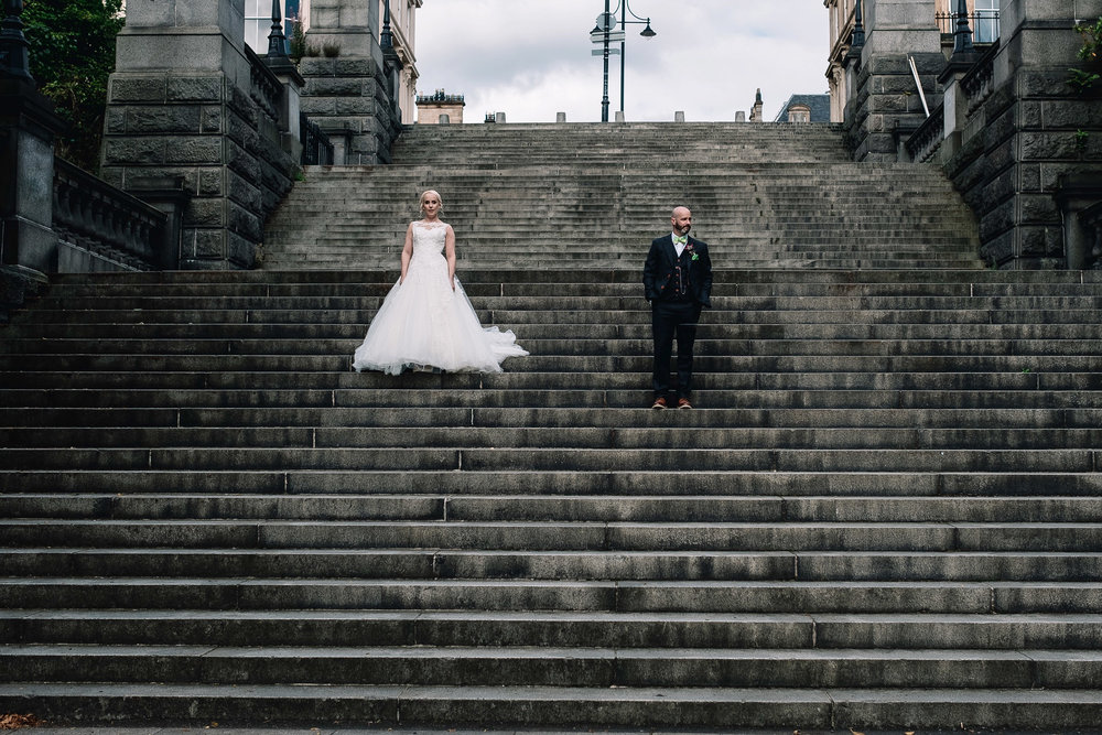 Bride and groom walking in Glasgow West End