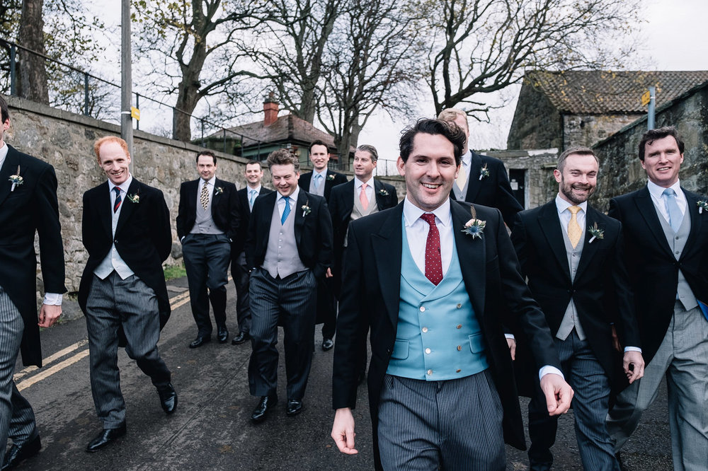 Groomsman walking wearing morning suit