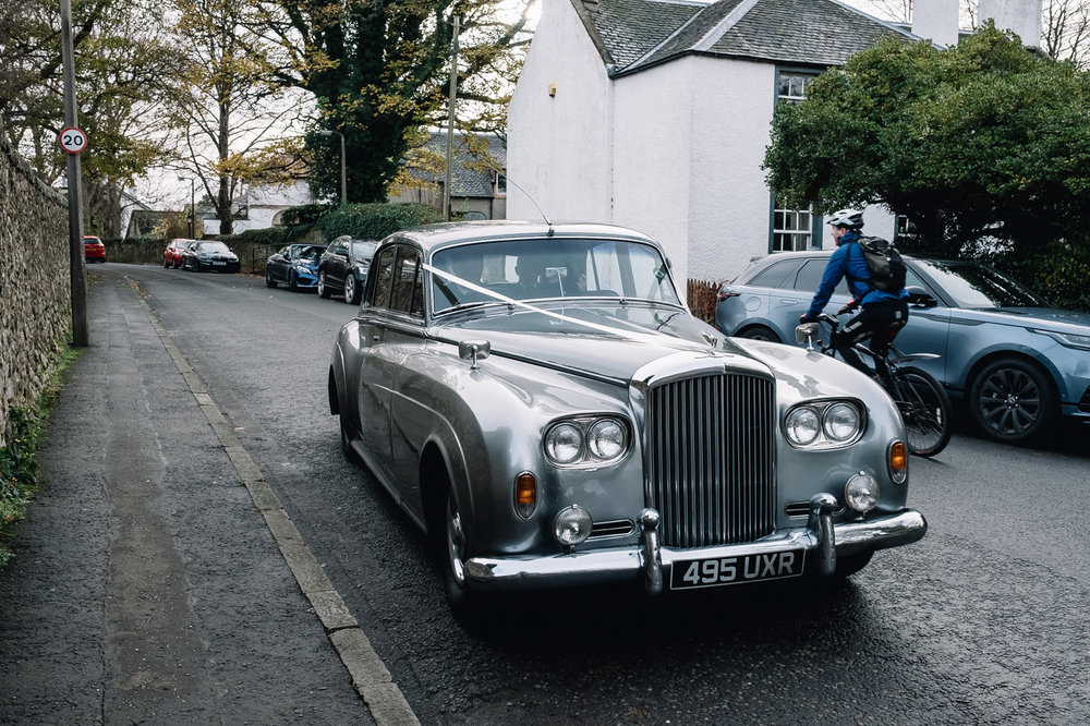 Classic Bentley arrives with bride