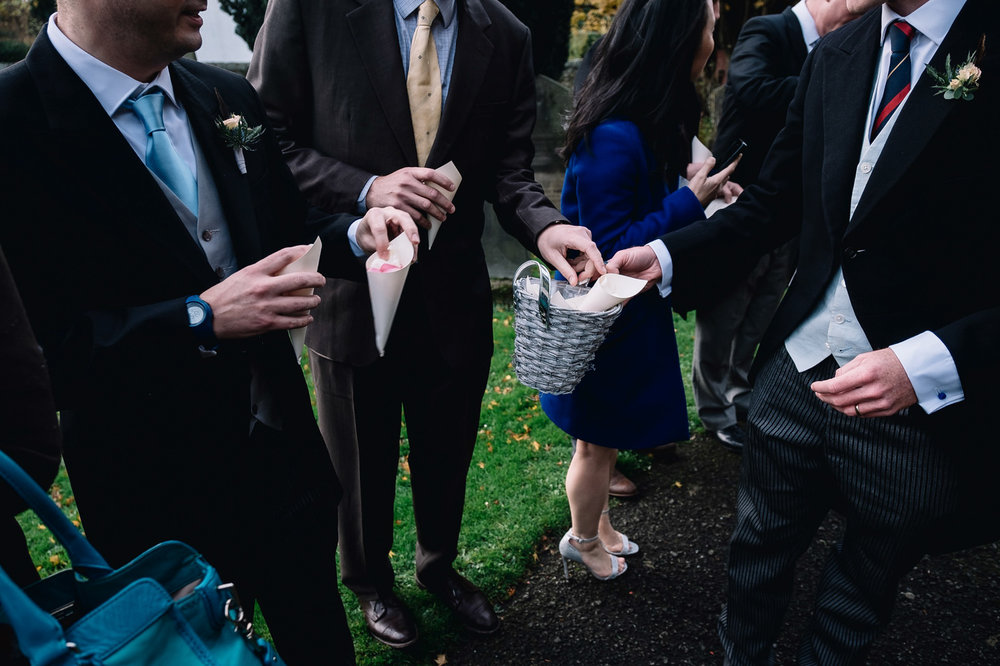 guests hold confetti cones