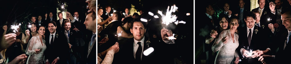 wedding party enjoy winter sparklers