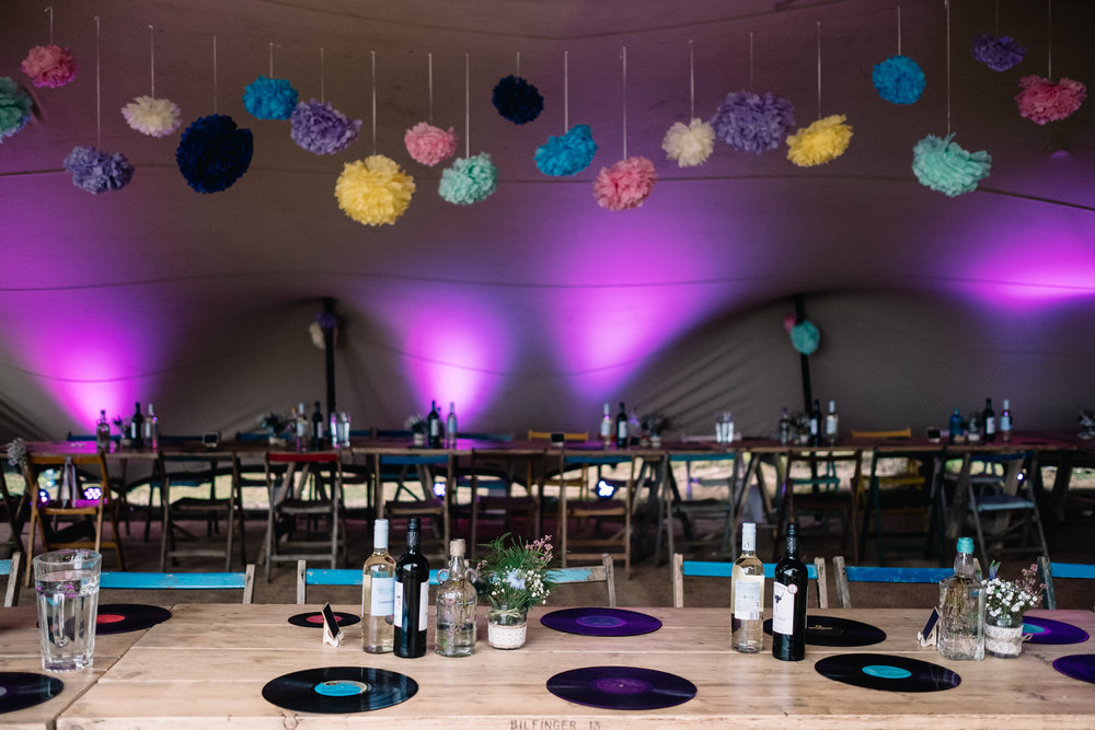 Inside the tent at Ravenshuegh Log Cabin. Beautifully + colourfully decorated for the evening reception.