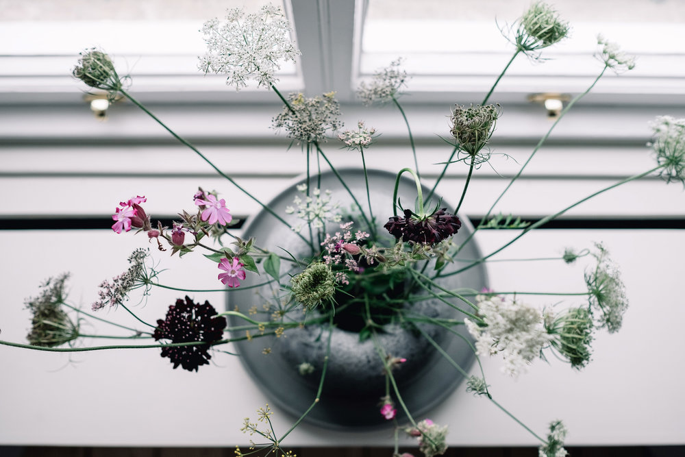 simple flower arragement on kitchen window shelf