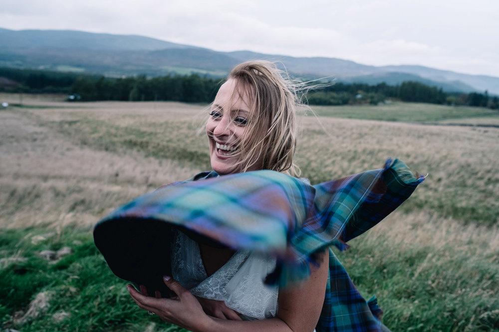 Bride's tartan scarf blows in the wind