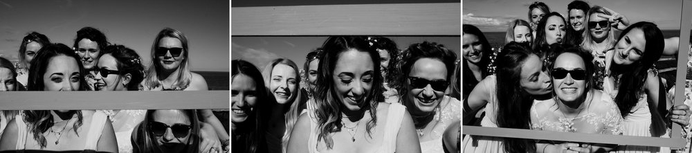 Fun and laughter is being had as bridal party make group portraits