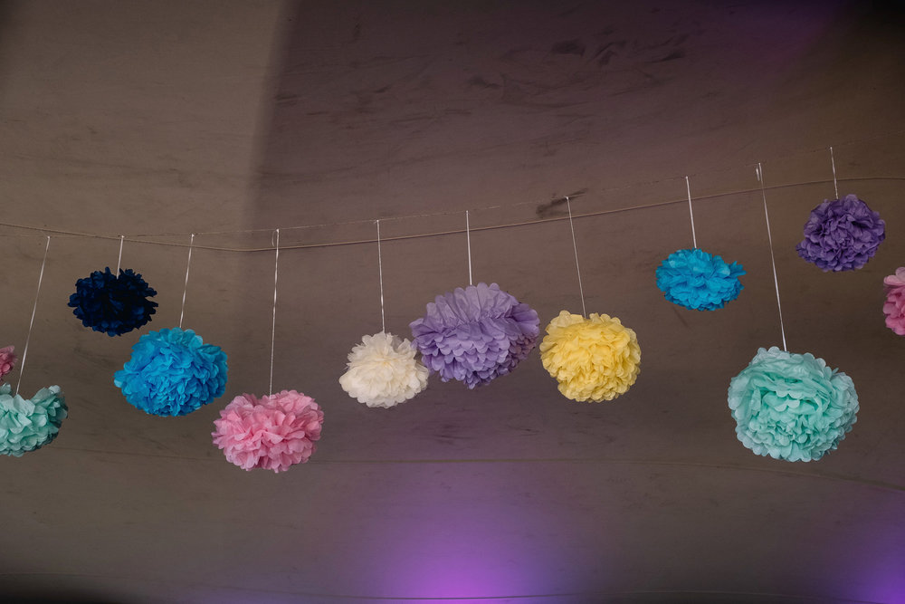 coloured paper lanters hanging from inside tent