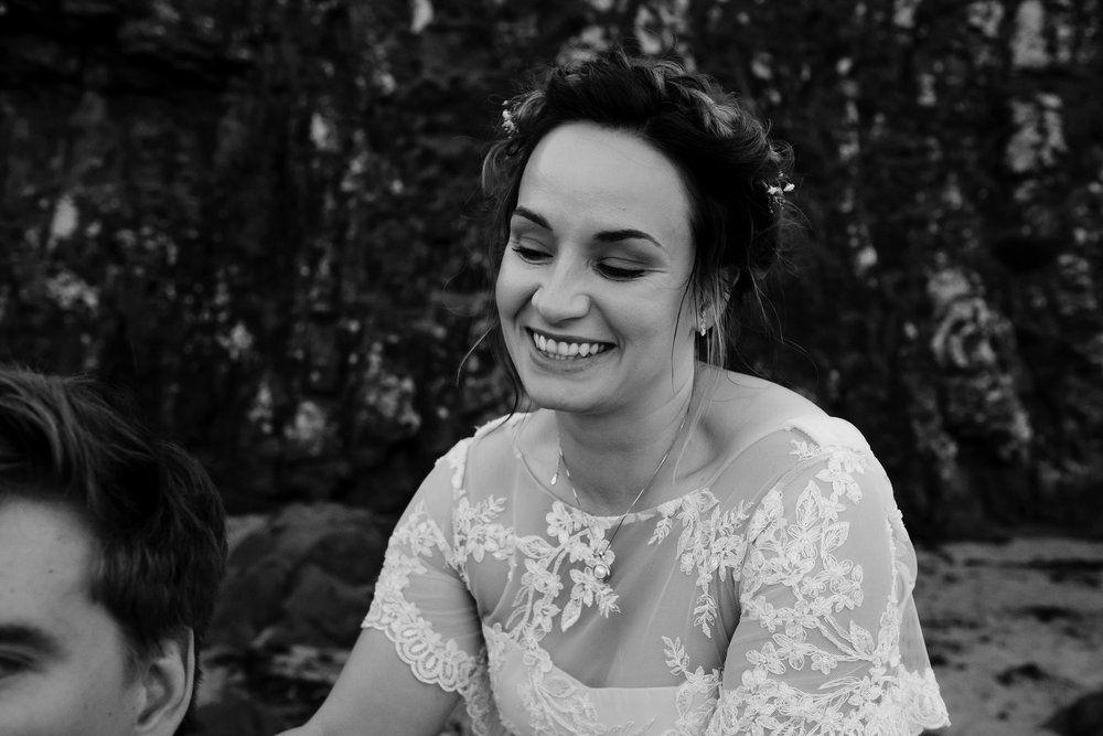 Bride smiles and looks at her new husband