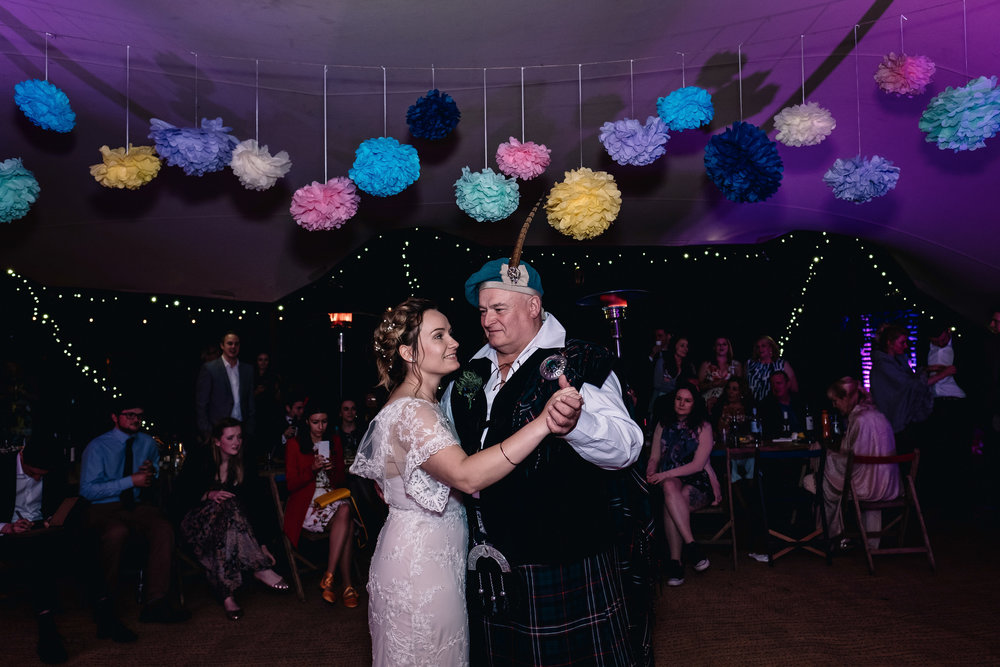 Smiling father and daughter during first dance.