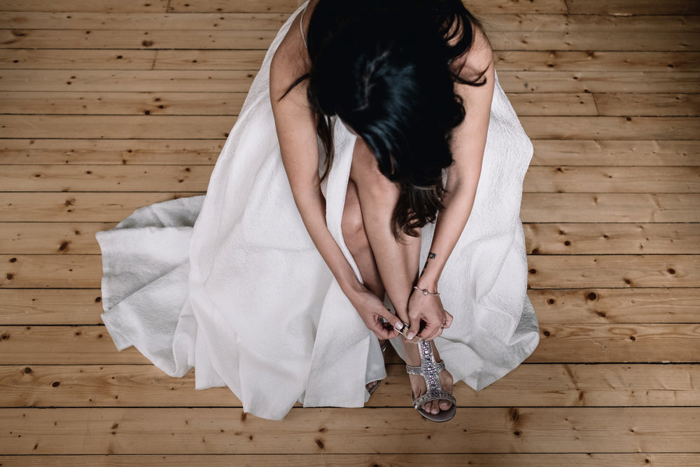 Brides is fixing her shoes in the bridal suite of Achnagairn Estate.
