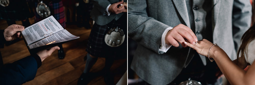 Groom places ring of bride's finger during wedding ceremony.
