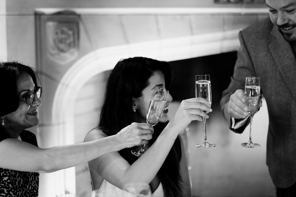 Bride, groom + bride's mother share a toast during the groom's speech.