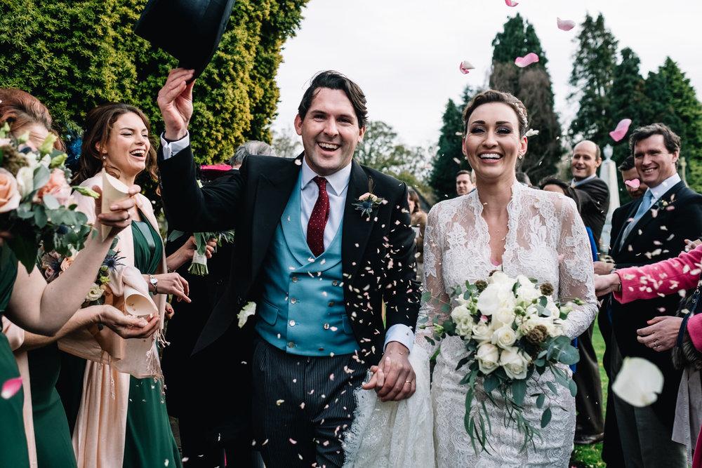 Bride and groom enjoy the confetti throw.