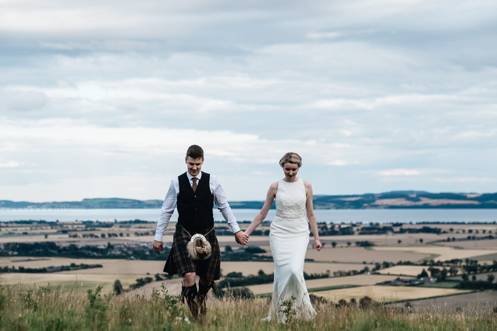 a couple walk up the hill at the back of Guardswell Farm.