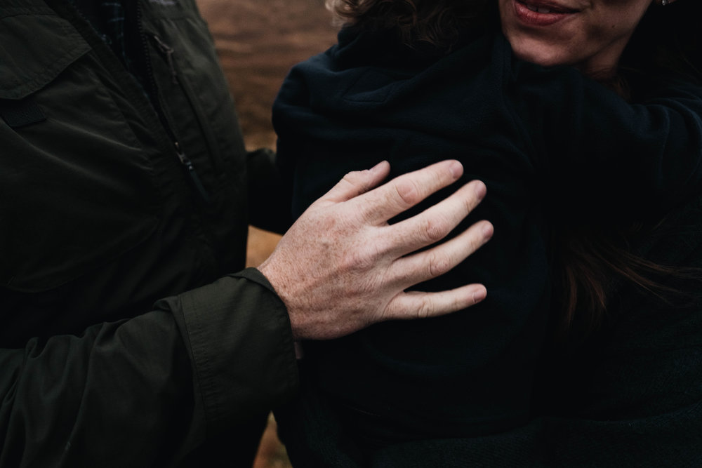 Father holding mother's arm