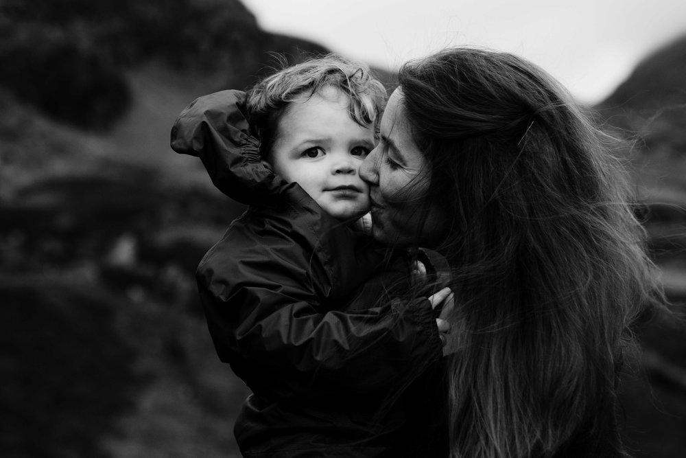 mother kisses child