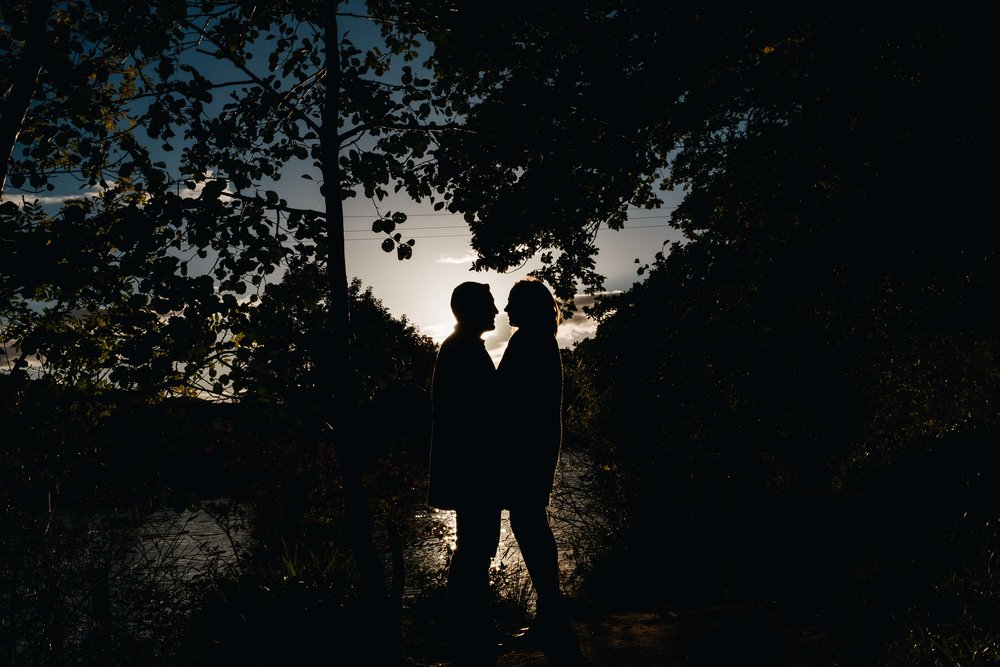 couple hug and are silhoutted