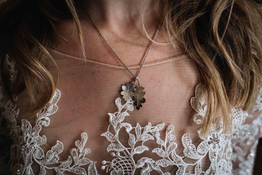 close up of bride's feather necklace