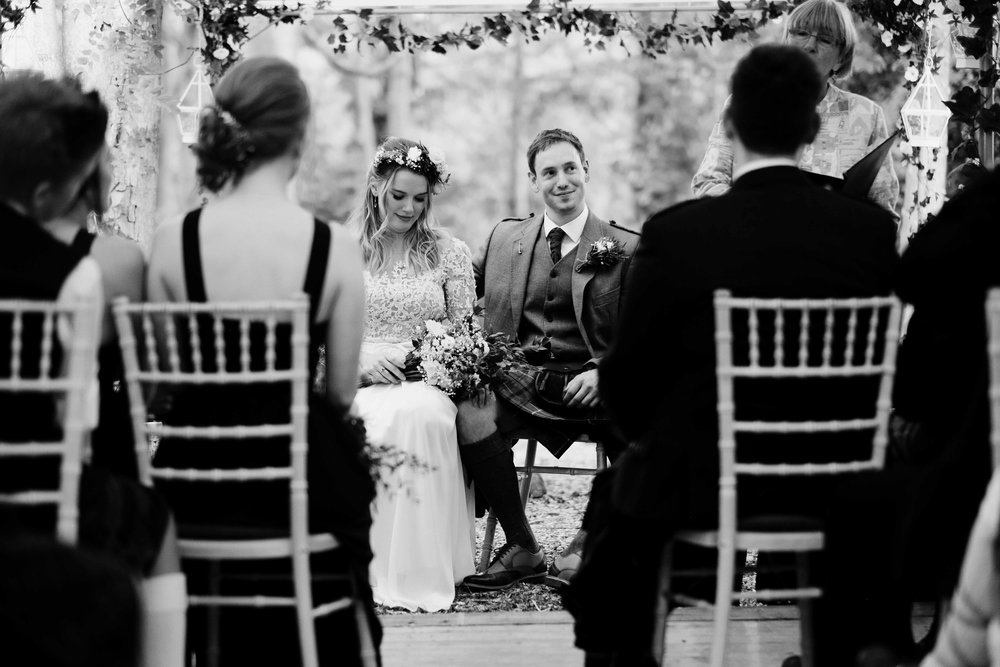 bride and groom sitting during their wedding ceremony