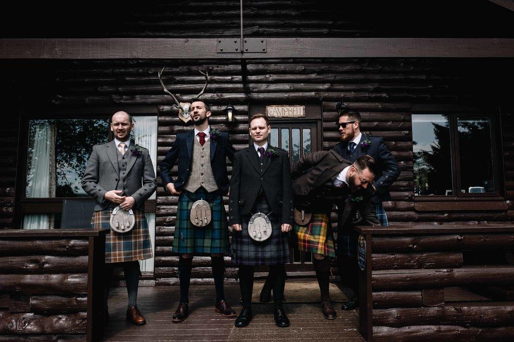 groomsmen standing outside