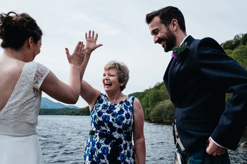celebrant high fives her couple whom she's just married