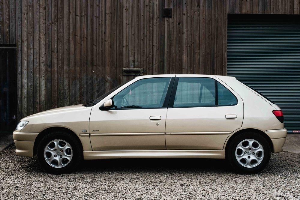 gold Pugeot bridal car