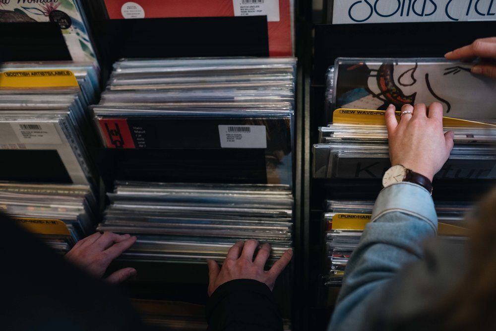 An engaged couple are looking through records in an Edinburgh record store.