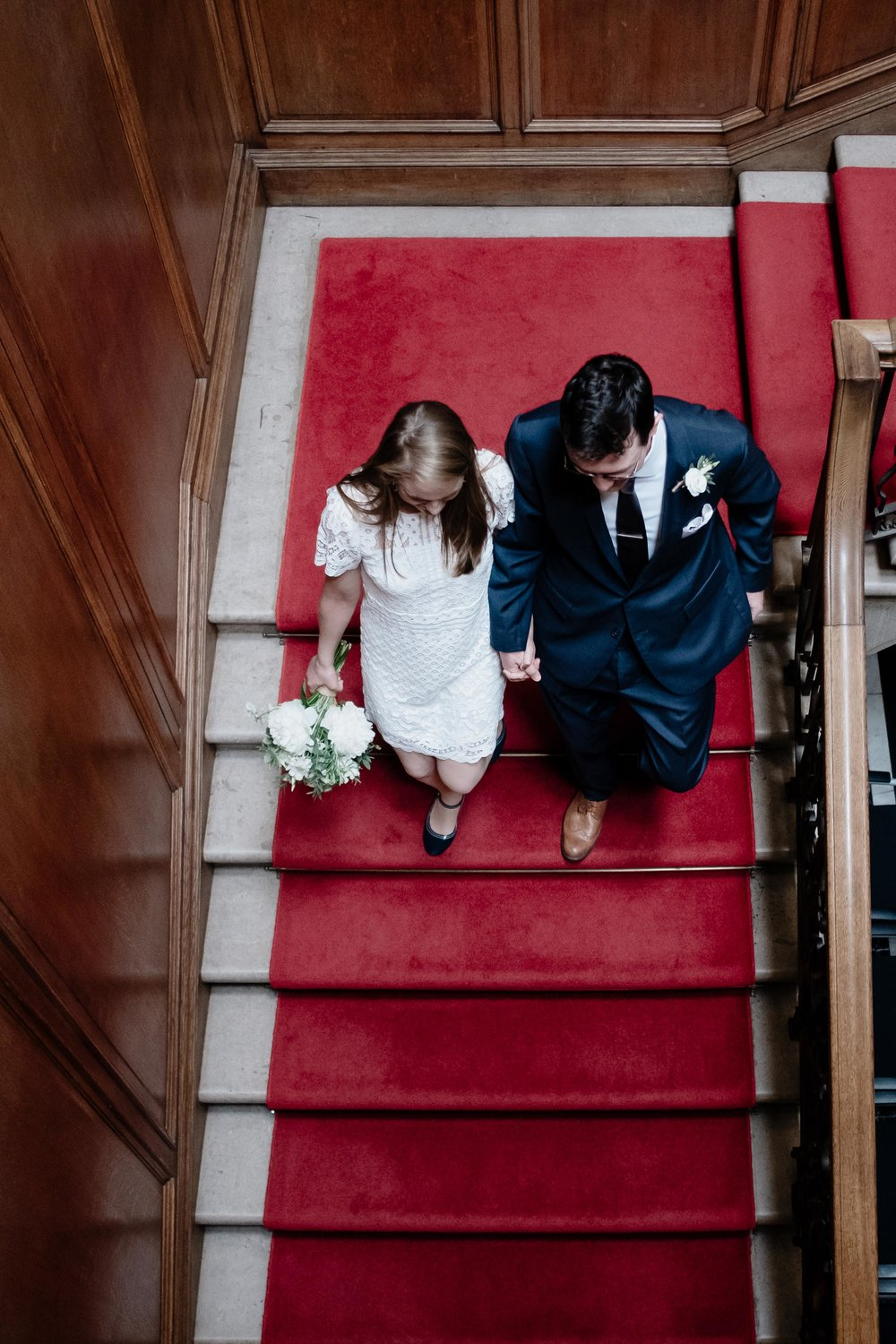 Couple have just eloped in Edinburgh and are walking down the stairs of the Edinburgh Registry Office.
