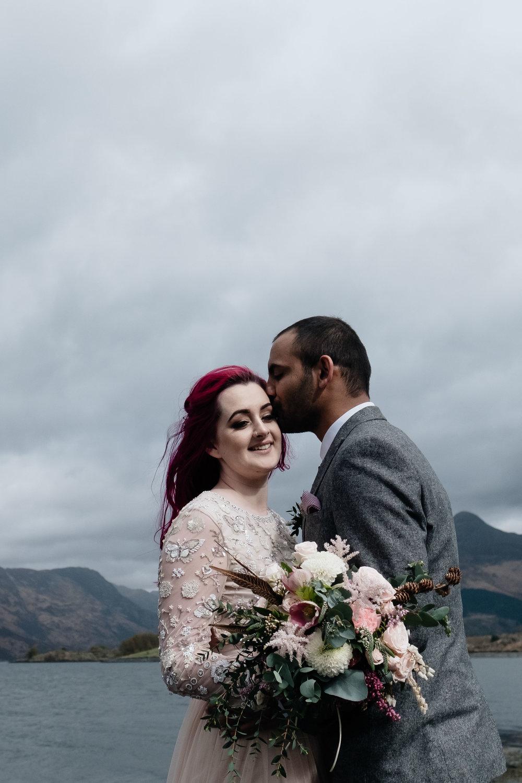 Groom kisses his bride following their Glencoe elopement.