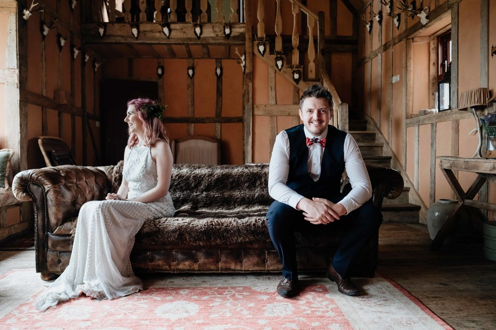 bride and groom sitting on a chair.