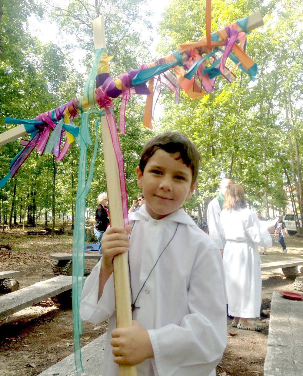 Acolyte w Colorful Cross on the Land.jpg