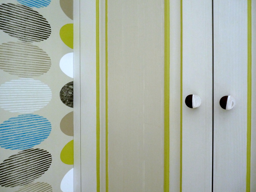 colour matching and combed paint finish to Designer Guild wallpaper on fitted wardrobes