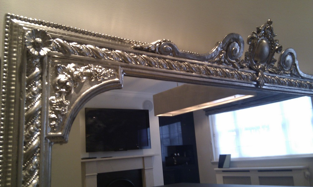 Overmantel mirror restored and re gilded with palladium leaf