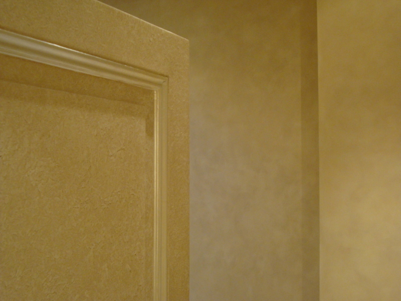 Paint finish to Door with White Gold Gilding mouldings. Colourwash on Bedroom walls beyond.