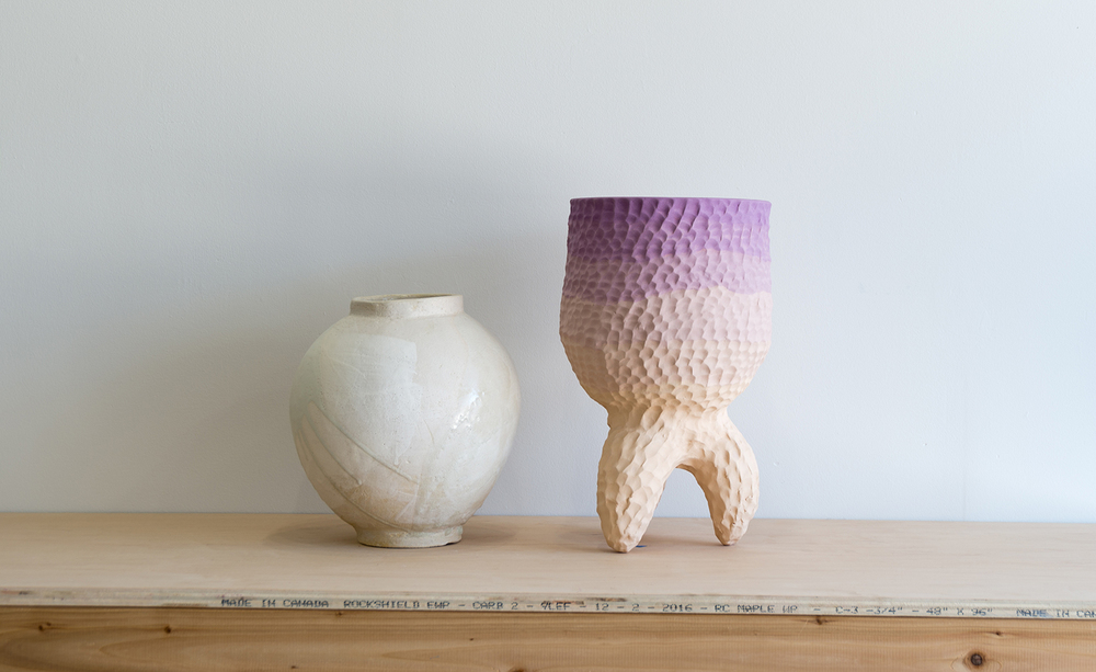 'I've always been interested in the use of craft materials in contemporary art. I feel that clay in particular is a dynamic material that is used to create everyday objects as well as fine art,' Curtis explains. Pictured: a  vessel  by Romy Northover (left) and a standing vessel by Sean Gerstley (right) via WALLPAPER