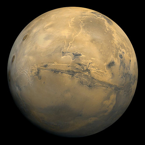 Mars is home to the largest canyon in the solar system. Soon, a lucky couple might be seeing it up close.  (Image credit: NASA)