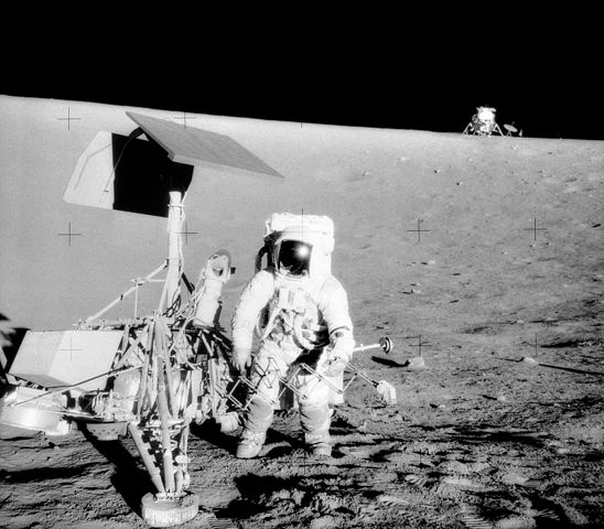 Astronaut Pete Conrad examining Surveyor 3, which carried living bacteria to the Moon (Image credit: NASA)