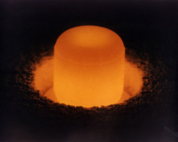 A pellet of plutonium-238 glows from its own internal heat.  (Image credit: US DoE)