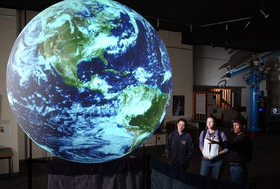 One goal of the exhibit is to provide accompanying information for Science on a Sphere.  (Image credit: Fiske Planetarium)