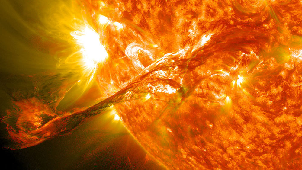 A solar flare observed in late 2012. The ejected material, seen on the left, is several times larger than the Earth. (Image credit: NASA)