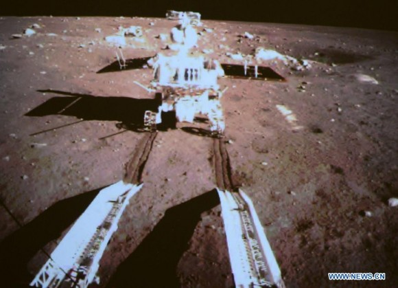 This image taken by the Chang'e 3 lander shows the Yutu rover rolling onto the lunar surface. (Image Credit: CNTV)