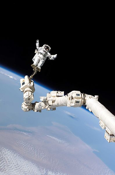 Astronauts sometimes get some help when working in space.  (Image credit: NASA)