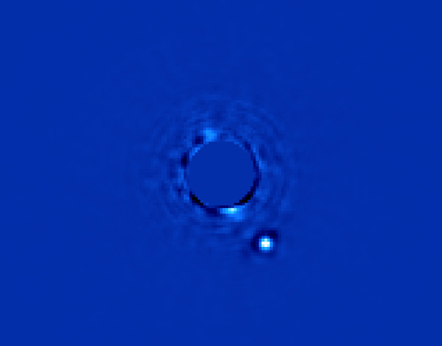 GPI first light image of Beta Pictoris B.  The large circle is the star, the smaller one is the planet. (Image credit: Processing by Christian Marois, NRC Canada)