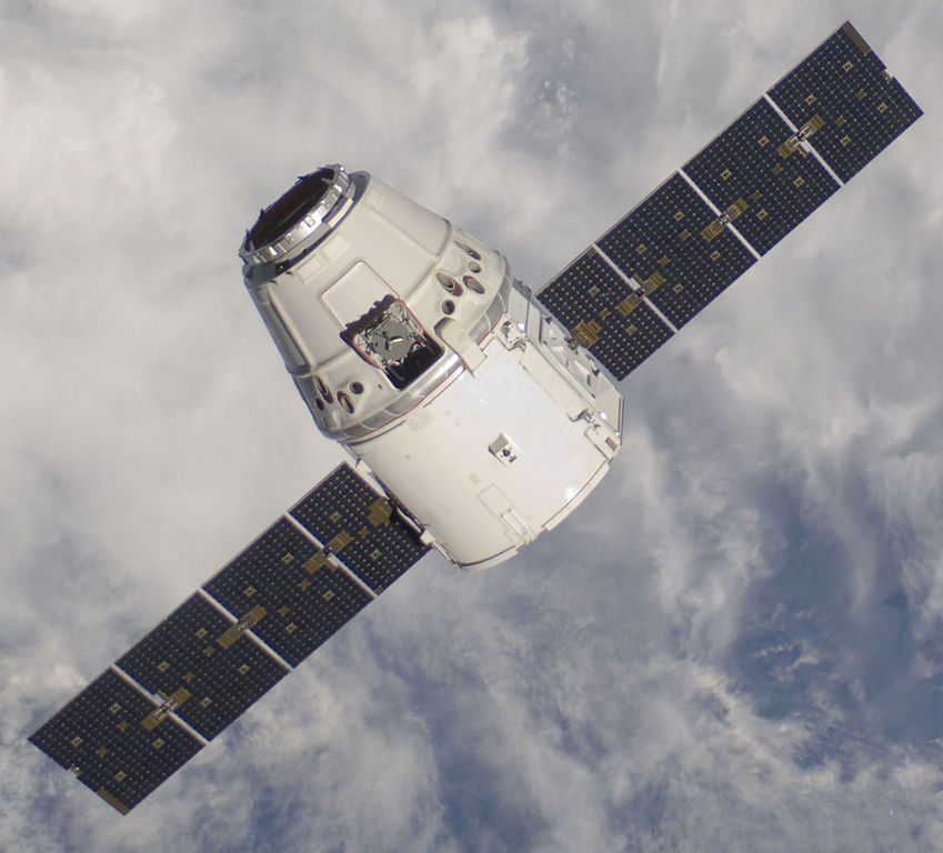 SpaceX's Dragon capsule has already made two deliveries to the ISS.  It could begin ferrying crews as early as next year.  (Image credit: NASA)