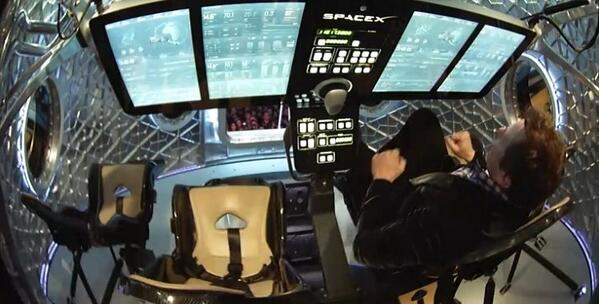 SpaceX CEO Elon Musk at the controls on the Dragon V2 during last night's unveiling.  (Image credit: SpaceX)