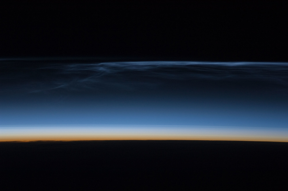 "Astronauts on the International Space Station orbiting at an altitude of 422 km (262 miles) took this image above Mongolia. Noctilucent clouds are a common sighting from the ISS. (Image Credit: ""Iss017e011632"" by NASA)"