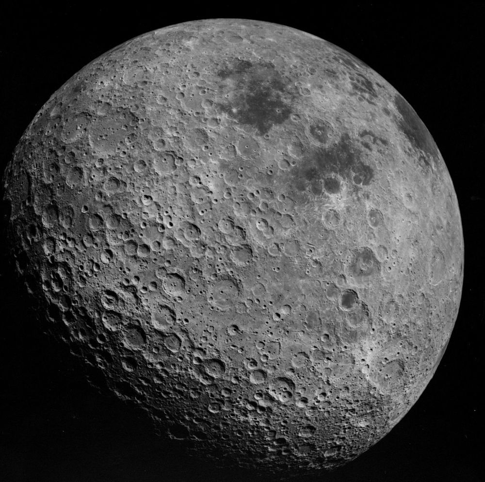"""(Image Credit:By Apollo 16 astronauts (NASA Apollo 16 photograph AS16-3021) [Public domain], via Wikimedia Commons) Pictured here is the lunar farside, sometimes called the """"dark"""" side of the moon, which, by the way, is a complete misnomer because it is illuminated by the sun just as often as the side facing Earth. We call it the """"dark"""" side of the moon because we fear the dark much like we fear the unknown and it makes for great horror-film-esque movies like Apollo 18."""