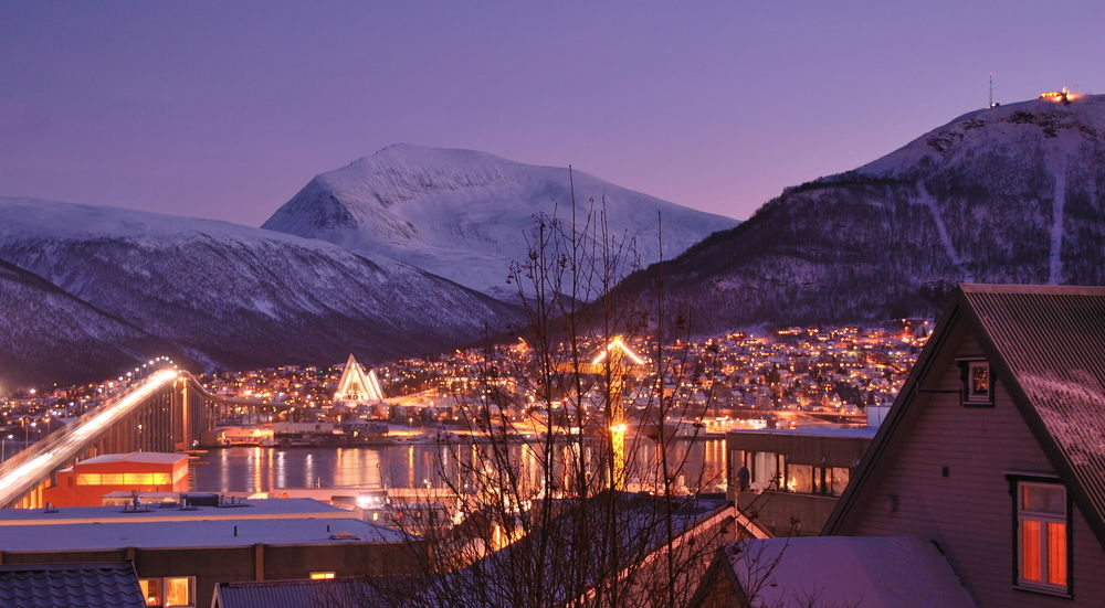 I've been spending a lot of time in the dark lately, but at least I live at 40 degreesnorth, not 70 degreesnorth in Tromso, Norway. This is a picture of a typical afternoon during the winter- although the sun isn't above the horizon, it illuminates the sky to a dark blue hue. (Image Credit:Osopolar (Own work), via Wikimedia Commons)